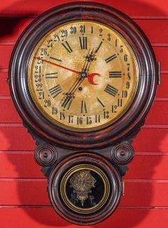 A LOVELL MFG FAUX ROSEWOOD IONIC CALENDAR CLOCK