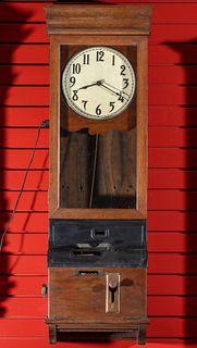 AN EARLY 20TH CENTURY OAK TIME CLOCK