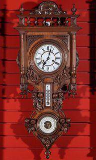A CARVED WALNUT HAMBURG AMERICAN CLOCK BAROMETER