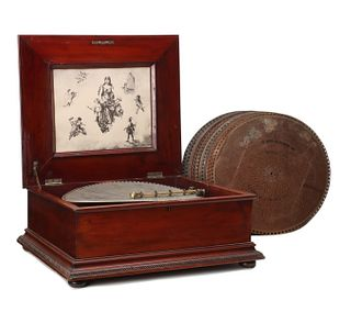 A REGINA DOUBLE COMB DISC MUSIC BOX IN MAHOGANY CASE
