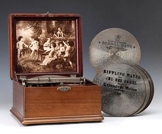 A NICE MAHOGANY CASE MIRA DISC MUSIC BOX WITH DISCS
