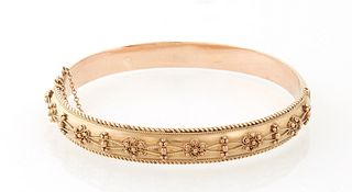 English Victorian 9K Rose Gold Etruscan Style Hinged Bangle Bracelet, early 20th c., the top with relief decoration, flanked by rope...