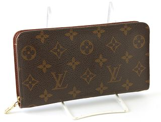 Louis Vuitton Men's Zippy Long Wallet, the brown coated monogram canvas with golden brass accent zippers, opening to two bill compar...
