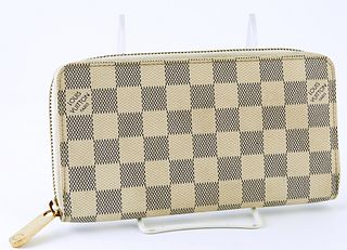 Louis Vuitton Ivory Zippy Wallet, the coated canvas damier azur with a golden brass accent zipper, opening to two card holders, a zi...