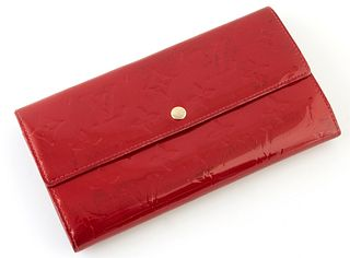 Louis Vuitton Rouge Fauviste Monogram Sarah 10 Wallet, the calf leather with golden brass accents, opening to two card holders, thre...