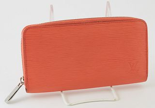 Louis Vuitton Coral Orange Zippy Wallet, the calf leather epi with a silver accent zipper, opening to two card holders, a zip pouch,...