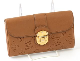 Louis Vuitton Cognac Monogram Mahina Iris Wallet, the calf leather with golden brass buckle clasp, opening to three bill compartment...