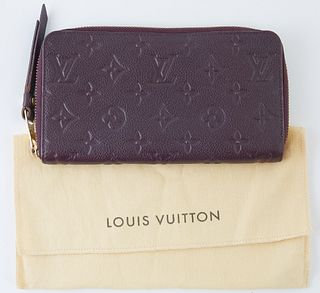 Louis Vuitton Dark Purple Monogram Empreinte Secret Wallet, the calf leather with golden accent zipper to leather pull, opening to t...