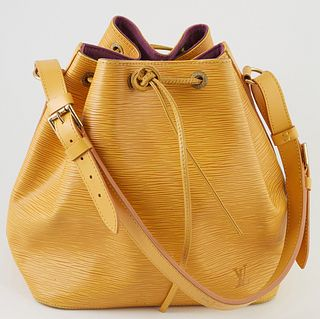Louis Vuitton Noe Yellow PM Epi Leather Shoulder Bag, with yellow stitching and brass hardware, opening to a purple suede interior w...