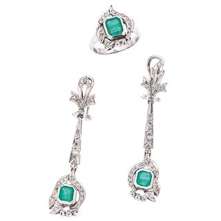 RING AND EARRINGS SET WITH EMERALDS AND DIAMONDS. PALLADIUM SILVER