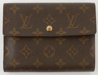 Louis Vuitton Porte-Tresor Etui Papier Wallet, the brown monogram coated canvas with a brass accent snap, opening to one card holder...