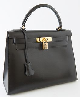 Hermes Kelly Sellier Black Box Leather Handbag, c. 1992, with gold hardware, opening to a black leather interior, one side with a zi...
