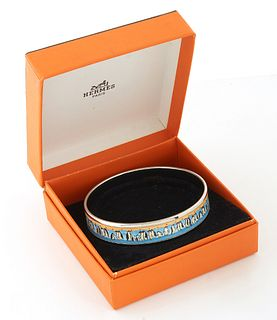 Hermes Stainless Steel Enamel Bangle, with penguin motif, made in Austria, with Hermes presented box, Dia.- 2 3/4 in.