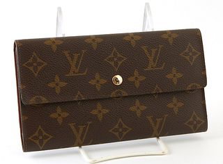 Louis Vuitton International Wallet, the brown monogram coated canvas with golden brass accent snap, opening to one card holder compa...