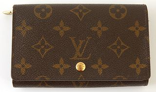 Louis Vuitton Porte-Tresor Zip Wallet, the brown monogram coated canvas with golden brass accents, opening to four main bill compart...