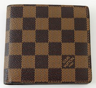 Louis Vuitton Brown Marco Wallet, the coated damier ebene canvas, opening to two bill compartments, one card holder, and a coin pouc...