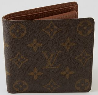 Louis Vuitton Marco Wallet, the brown coated monogram canvas, opening to three bill compartments, one card holder and one coin pouch...
