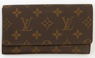 Louis Vuitton Vintage Long Flap Wallet, the brown monogram coated canvas, opening to two bill compartments, H