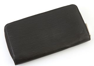 Louis Vuitton Black Epi Zippy Wallet, the calf leather with silver brass accents, opening to two card compartments, six bill compart...