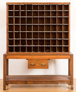 Oak two-part post office cabinet, early 20th c.