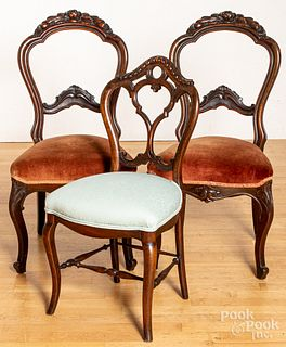Three Victorian carved walnut side chairs