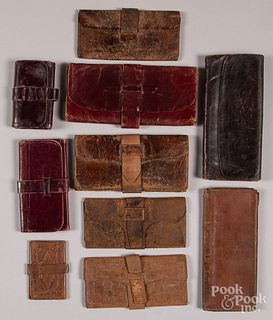 Collection of early leather pocketbooks.