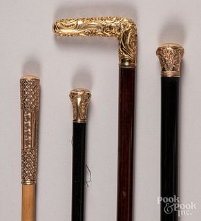 Four canes with gold filled grips.