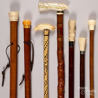 Seven canes with bone grips.