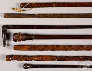 Seven assorted wood canes.
