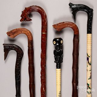 Six carved wood canes.