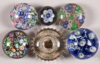Six glass paperweights.