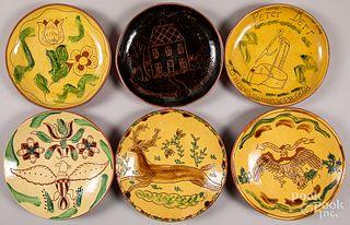 Six Breininger sgraffito redware plates