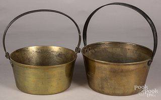 Seven brass and bell metal buckets and kettles