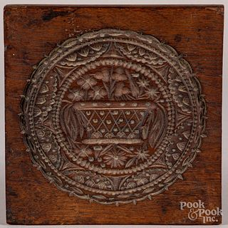 Carved walnut cakeboard, 19th c.