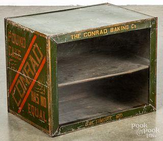 Conrad Baking Co. stenciled tin cake display case