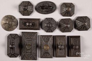 Twelve cast iron ink blotters, etc.