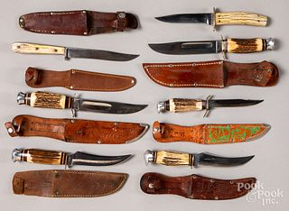 Seven fixed blade hunting knives and sheaths