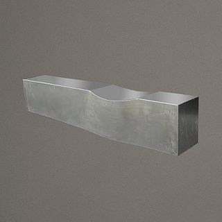 "Chris Howker para B&B Italia. Banca Dip en acero inoxidable / ""Dip"" stainless steel bench"