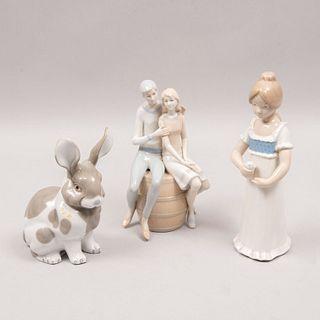 Lote de 3 figuras decorativas. España, Japón y México. Siglo XX. Elaborados en porcelana Rex, Esther y Cuernavaca. Acabado brillante.