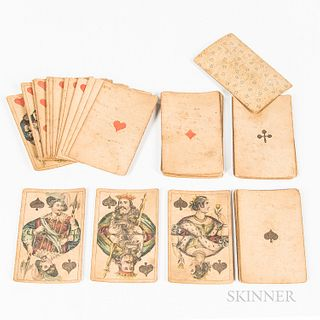 Deck of Early Playing Cards, complete set of 52 cards, with printed pips and royal figures.