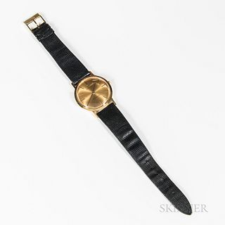 Juvenia Wristwatch, with a 21-jewel gold movement marked 18K, and a faux-shagreen band.