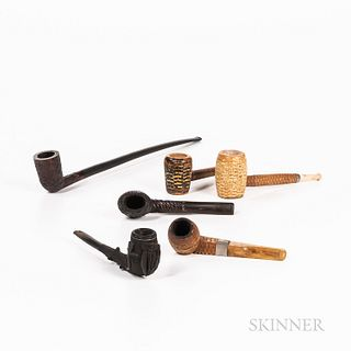 "Six Pipes, including three ""Corn Cob,"" one carved black hardwood with shamrock and harp, one ""Churchwarden"" pipe, and another."