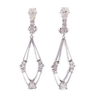 A Pair of Modern Diamond Dangle Earrings in 14K