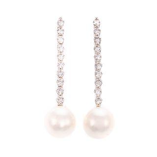 A Pair of Pearl & Diamond Drop Earrings in 14K