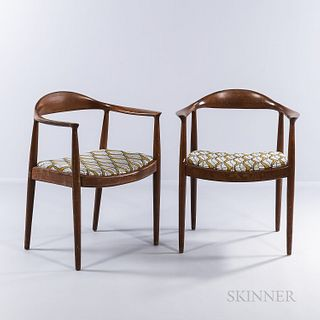 """Two Hans J. Wegner """"The Chair""""-style Armchairs, possibly Denmark, mid to late 20th century, teak, marked with metal Chase Bank property"""