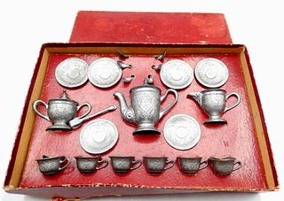 Complete pewter child's toy tea set in original box