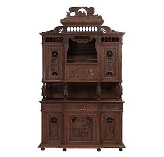 Buffet. Francia. Siglo XX. Estilo Bretón. En talla de madera de roble. Con 7 puertas abatibles, 3 cajones y soportes tipo bollo.