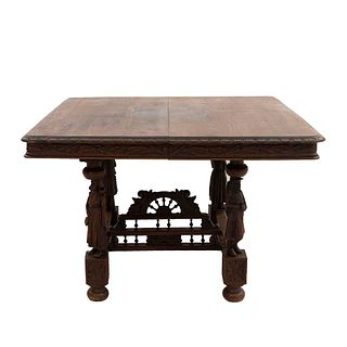 Mesa. Francia. Siglo XX. Estilo Bretón. En talla de madera de roble. Con cubierta rectangular y soportes tipo bollo.