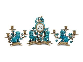 A Louis XV Style Gilt Bronze and Porcelain Clock Garniture