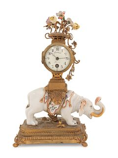 A French Porcelain and Gilt Bronze Mantel Clock